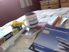 Buttercups, coffee cup, design books
